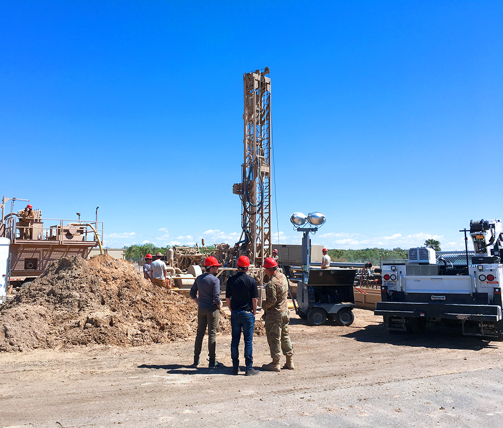 Groundwater Permitting and Well's Specialist at Luke Air Force Base watching/witnessing the drilling of a new well. (Photo taken in June 2019)