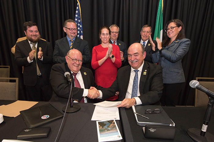 Officials with International Boundary and Water Commission, United States and Mexico, celebrate the signing of a new Colorado River agreement, Minute 323