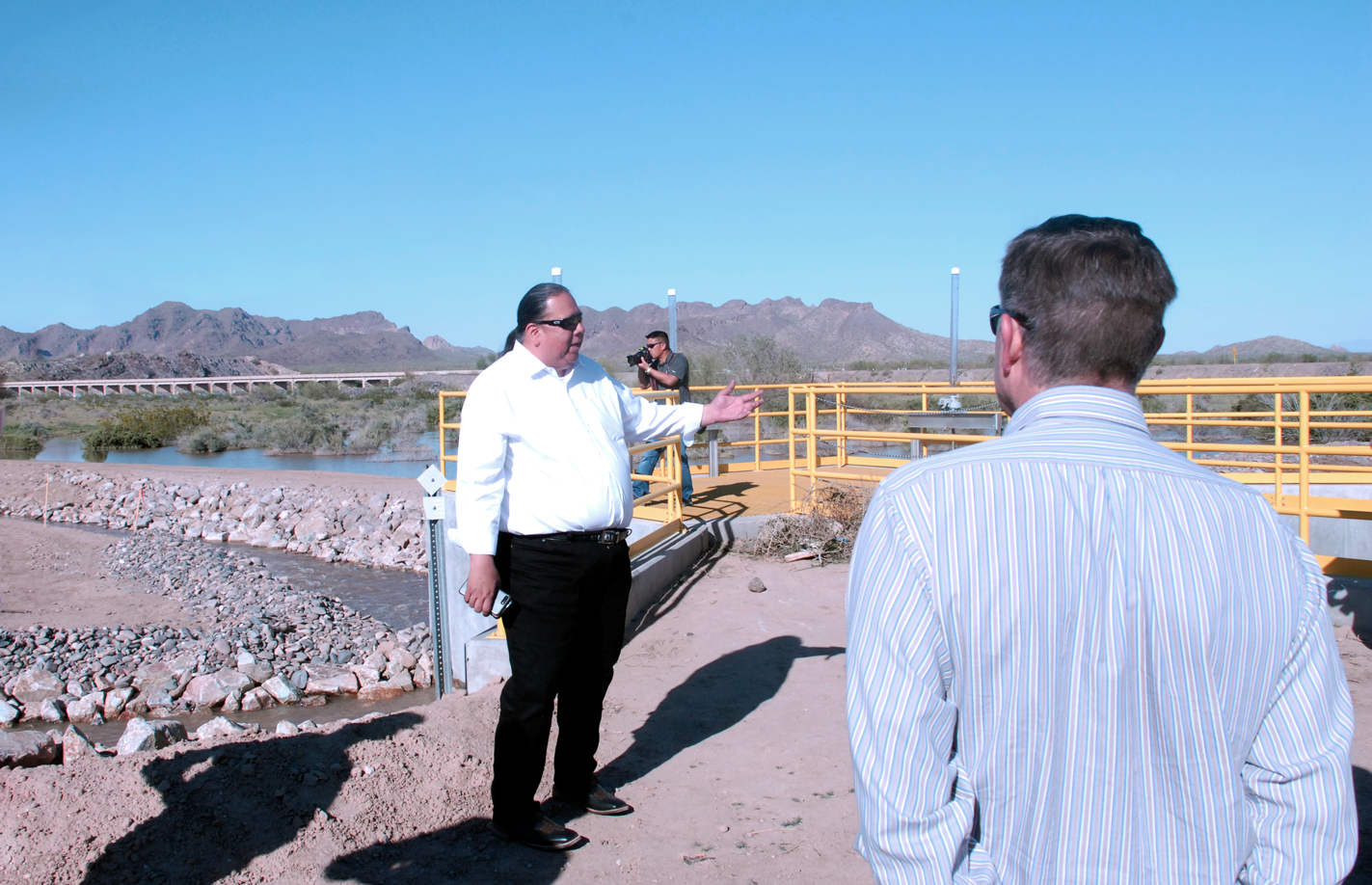 "Gila River Indian Community Gov. Stephen R. Lewis introduces visitors to the ""reinvigorated and redeveloped"" wetlands created by the tribe's new underground water-storage facilities."
