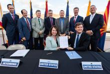 Representatives from the federal government and all seven Colorado River Basin states gathered at Hoover Dam in Boulder City, Nevada on May 20, 2019 to sign completed drought contingency plans.