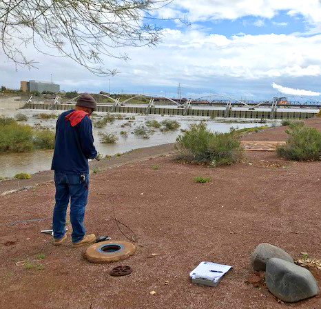 ADWR Field Service Specialist in Tempe measuring a well.